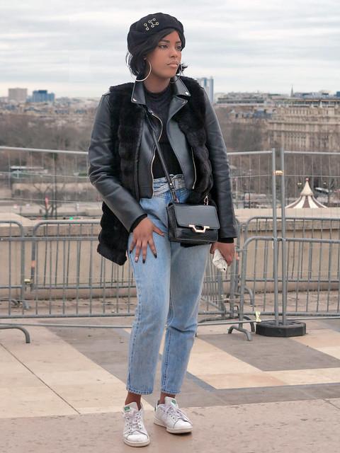 Black girl with hat and hoop earrings