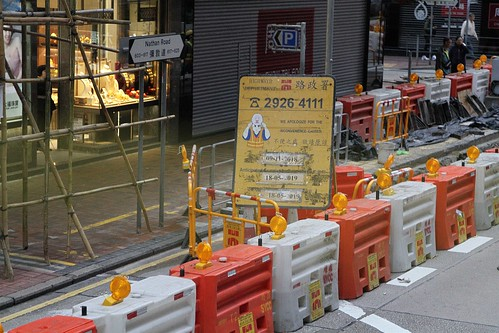 Highways Department 'We apologise for the inconvenience caused' sign on Nathan Road