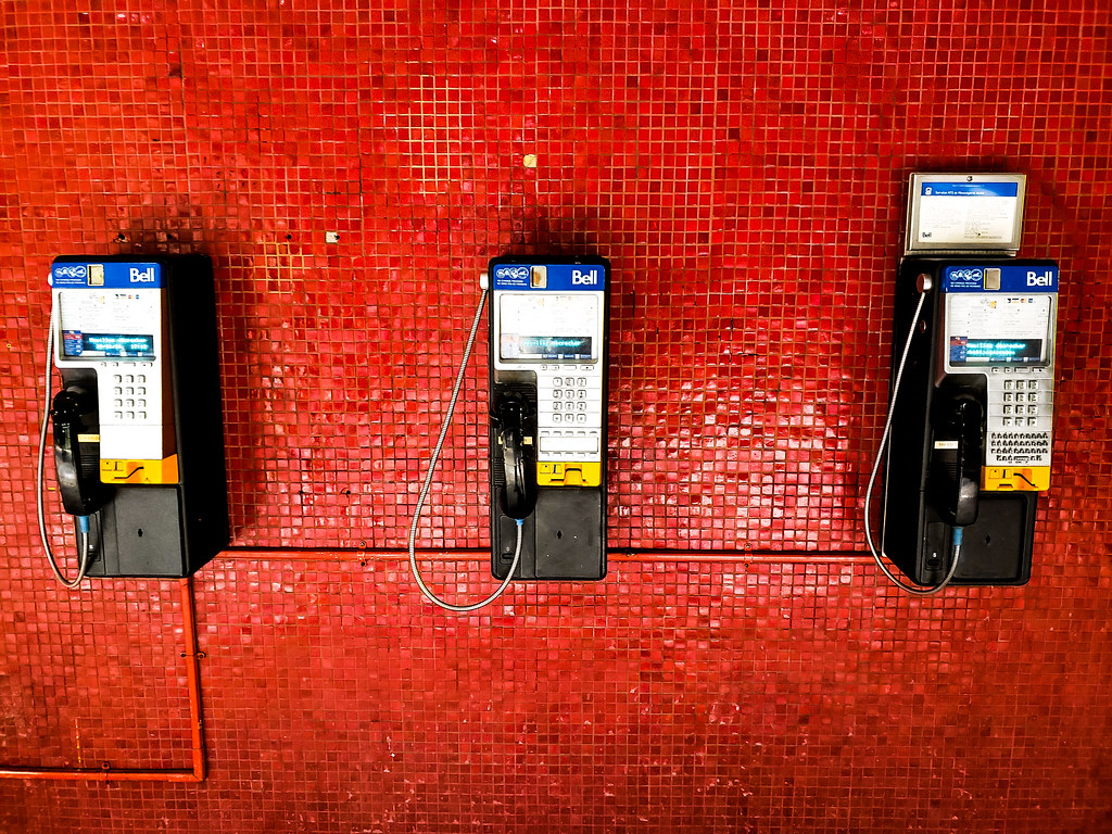 3 Payphones on a Red Wall