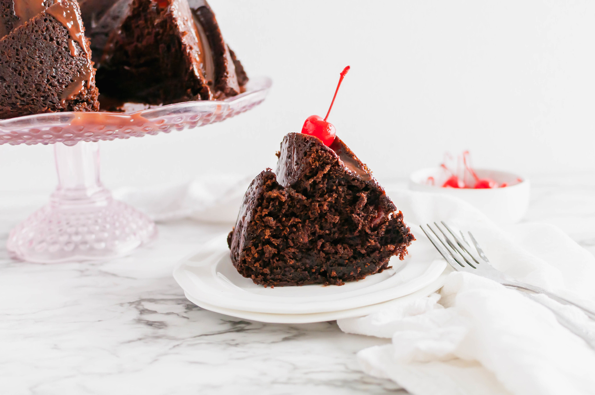Celebrate National Chocolate Cake Day with this Chocolate Cherry Cake. It's incredibly rich and packed with fruity maraschino cherries.