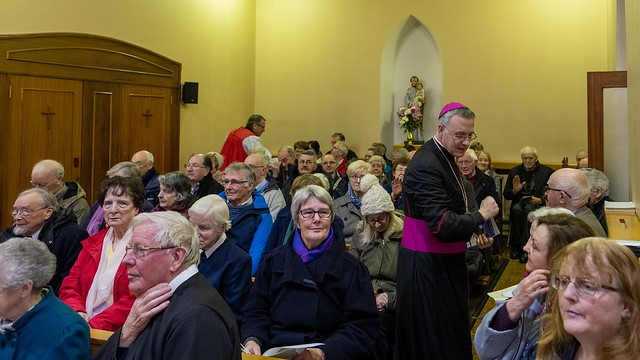The bishops sharing the peace in the packed Mount Carmel Chapel at the service of prayer for Christian unity. Photo: Larry Morgan.