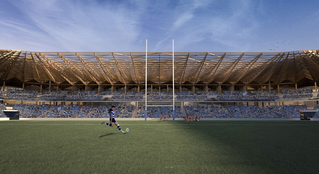 A CAD image of a Bath Rugby player about to kick a rugby ball in front of an imagined new south stand