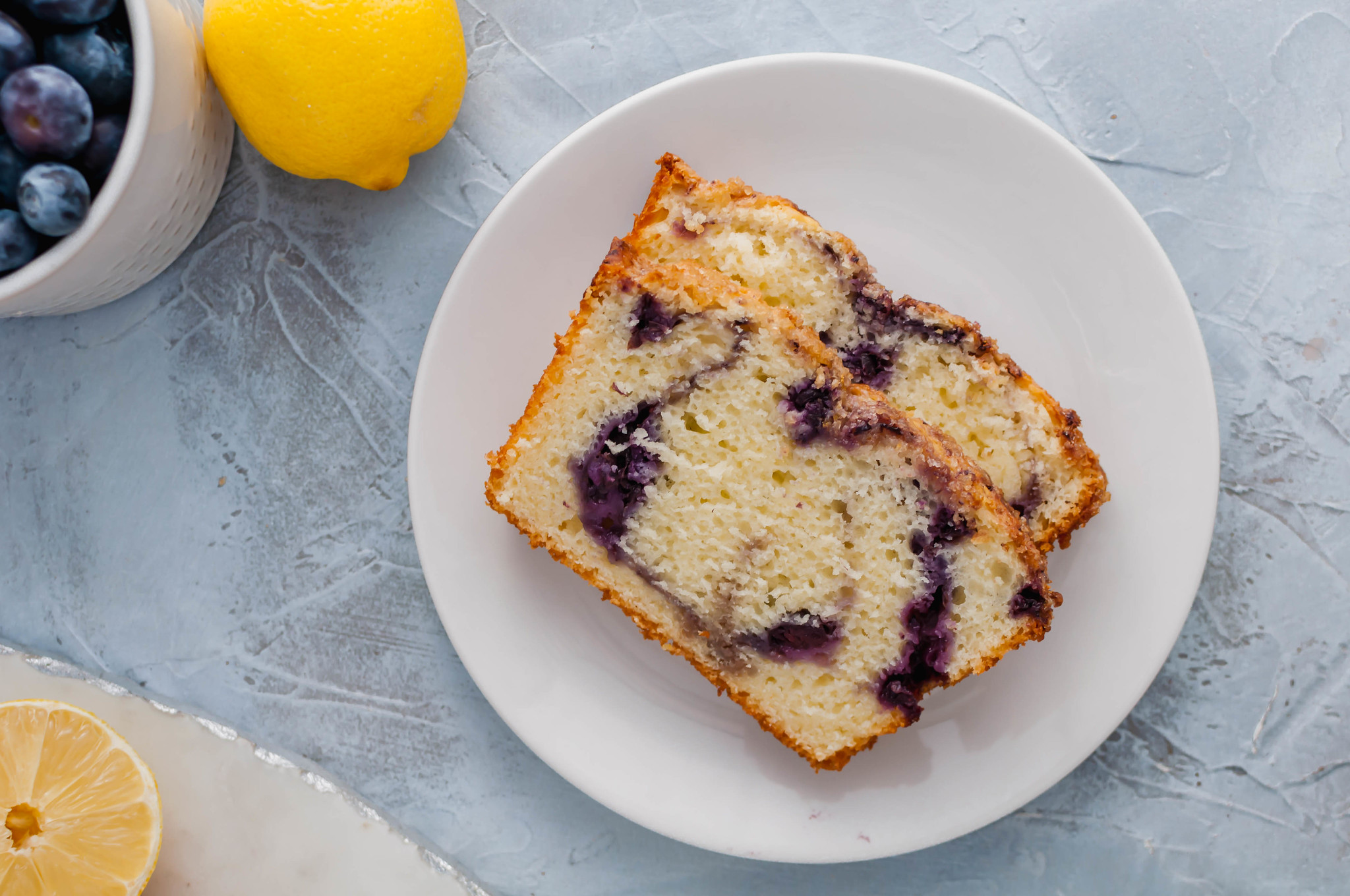 Blueberry Bread is a delicious breakfast option. Tender, moist quick bread swirled with homemade blueberry compote and topped with lemon sugar
