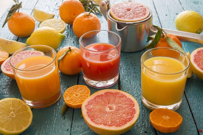 glasses-of-orange-juice--grapefruit-juice-and-multivitamine-juice--juice-squeezer-and-fruits-on-wood-548008985-571e7ce25f9b58857d2f53cb