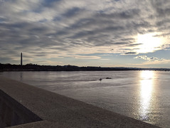 River, bridge, boat, monument, sun
