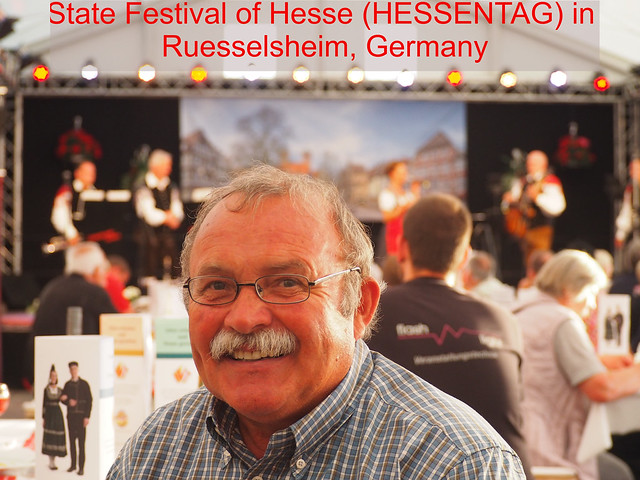 HESSENTAG in Germany 2017 - A Gurest listening to a Folk Music Group during the State Festival of Hesse in Ruesselsheim