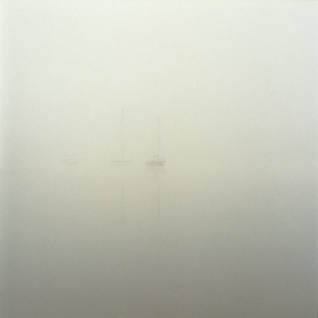 Yachts in the fog