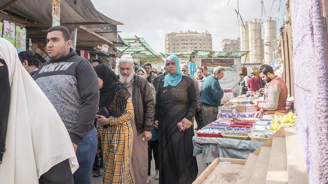 Egyptians passing by Al Azabekya market