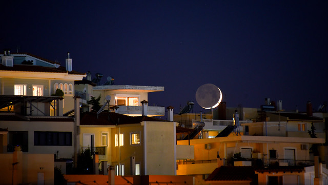 moonset over the roofs