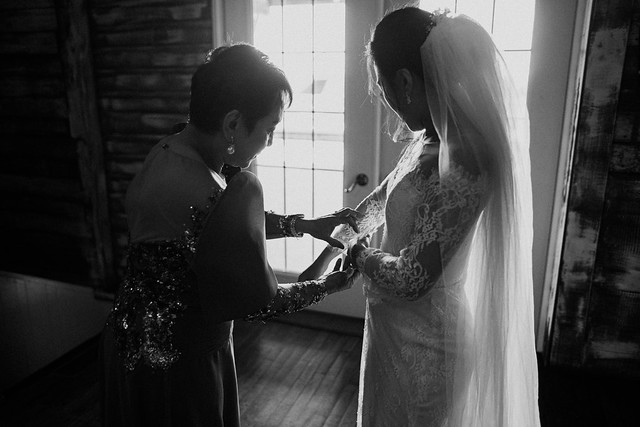 Mom Helping Bride with the Wedding Dress