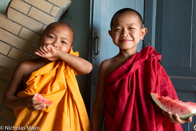 Young Monks Snacking On Watermelon