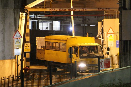 MTR truck crosses the level crossing on the siding tracks at Ho Tung Lau Depot