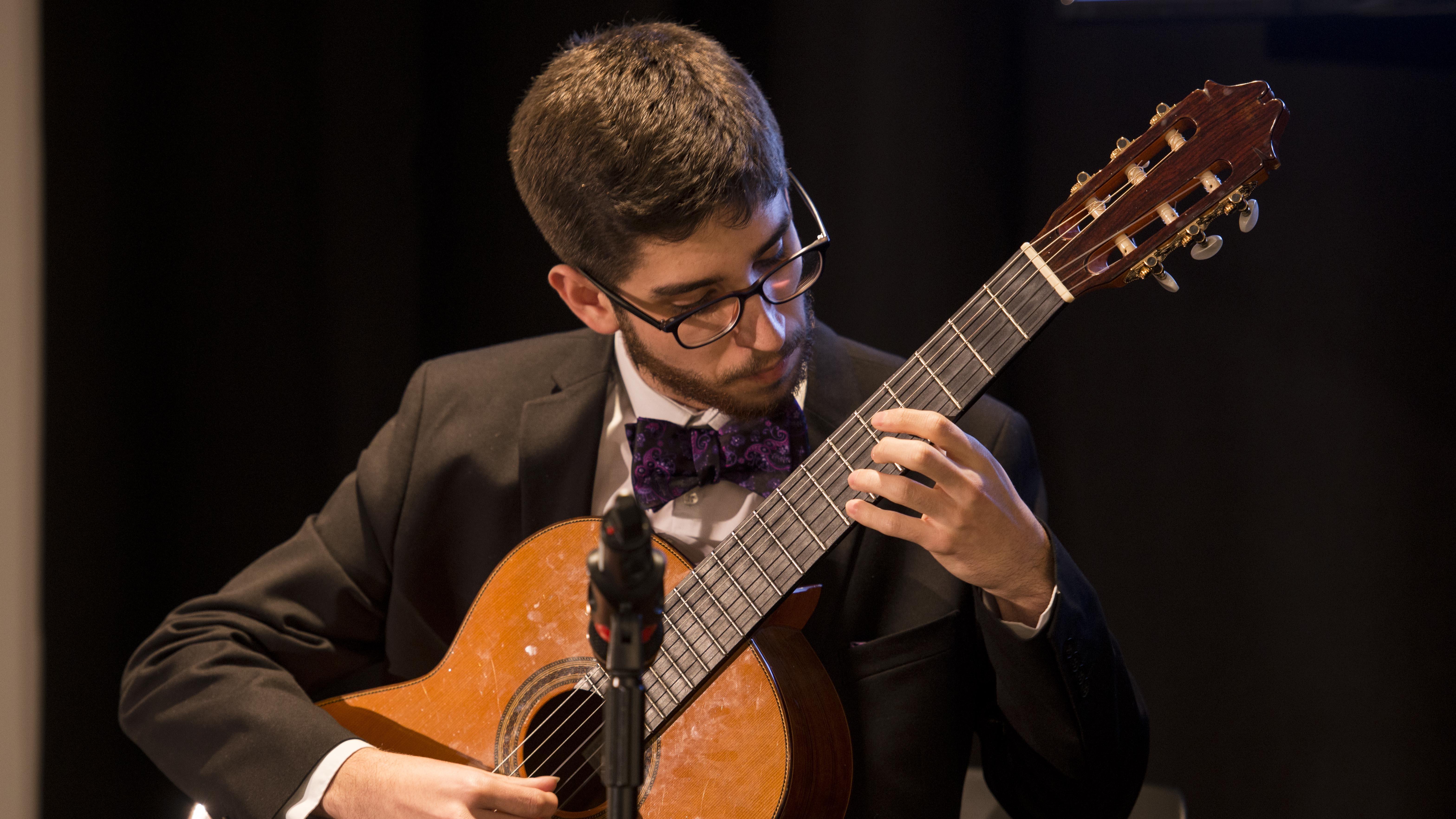 Andrés Lopez Moreno playing guitar