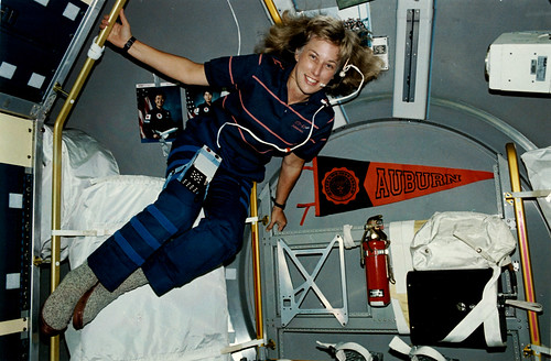 Jan Davis in the space shuttle with an Auburn pennant behind her