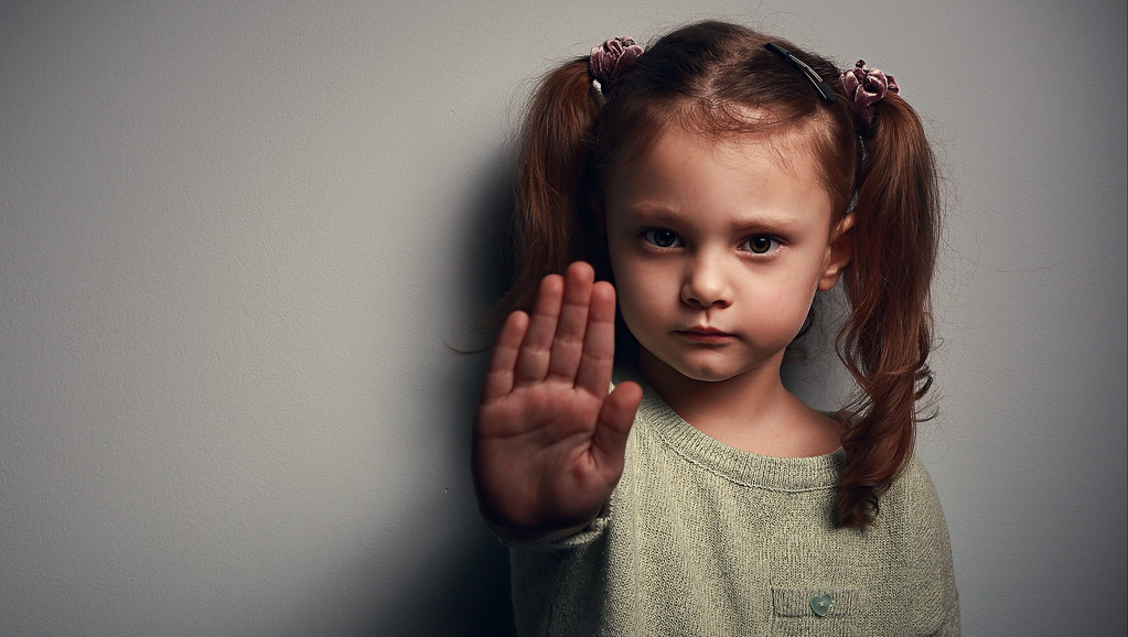 Image of young girl with hand up