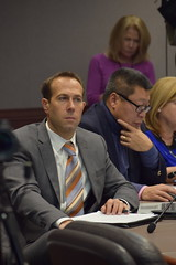 State Rep. Brian Farnen listens to the DOT Commissioner's presentation on truck-only tolling at the Transportation Committee's public hearing on tolls.