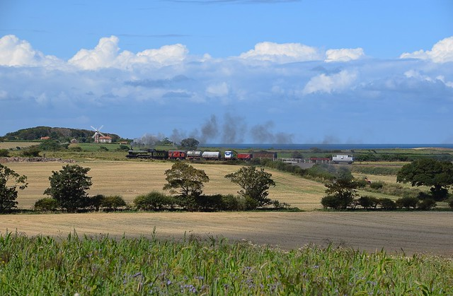 B12 Loco No.8572 heads a mixed Goods Service from Sheringham to Holt, past Weybourne Windmill. North Norfolk Railway. 01 09 2019