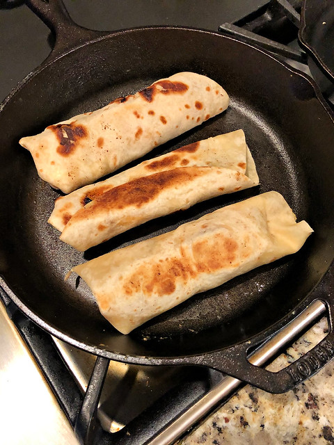 reheating breakfast burritos in a cast iron skillet