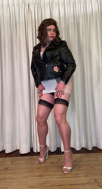 white minidress and leather jacket - front view