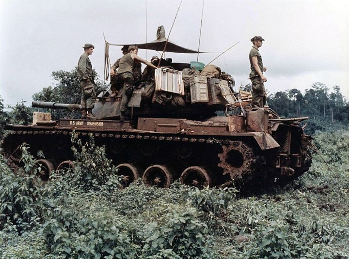 warhistoryonline: Men of Troop B, 1st Squadron, 10th Cavalry Regiment, 4th Infantry Division, and their M48 Patton tank move through the jungle in the Central Highlands of Vietnam, June 1969. https://wrhstol.com/3b4okKU