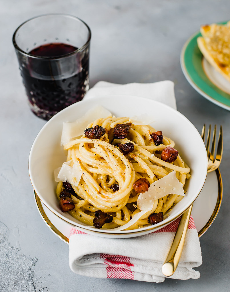 Classic bucatini carbonara, but with a decadent twist of salty guanciale, creamy egg yolks and extra cheese!