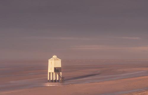 lowtide shadow sunrise lighthouse southwest somerset burnhamonsea