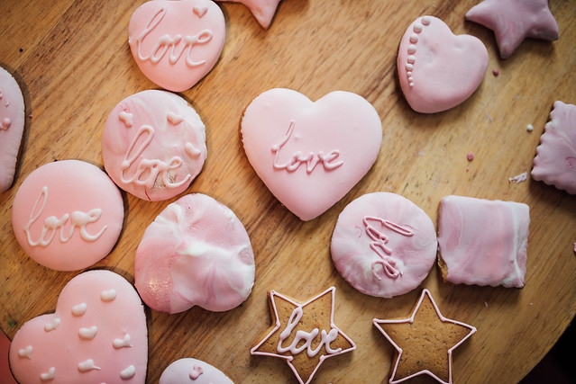 Pink valentine cakes on wooden table