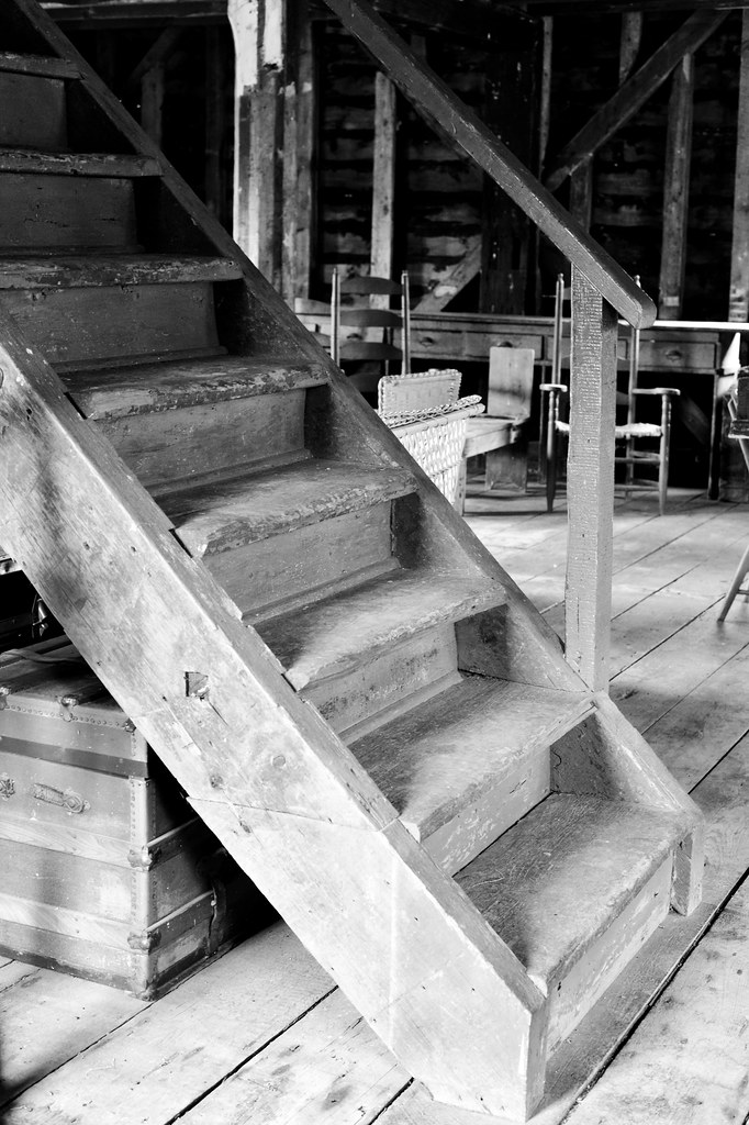 Wooden stairs going upstairs to the upper level of the Port Hope Mill , seen at doors open 2014 , photograph converted to black and white , Martin's photograph , Port Hope , Ontario , Canada , June 8. 2014