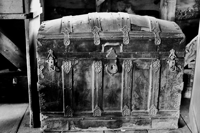 Antique Chest ; Antique leather wood banded Steamer trunk with nice hardware at the upper level , at the Port Hope Mill , seen at doors open 2014 , Martin's photograph , photograph converted to black and white , Port Hope , Ontario , Canada , June 8. 2014