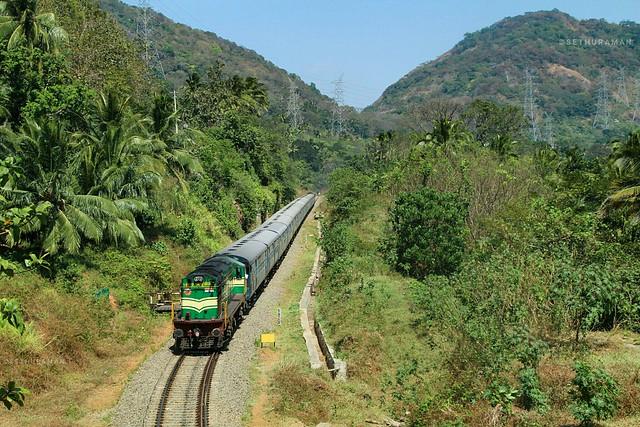 GOC WDG3A 14972 loco doing banking duty with Kollam-Sengottai passenger departs from Aryankavu....