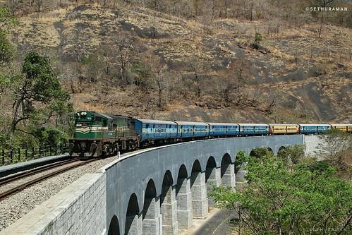 GOC WDG3A 13449 loco with Sengottai-Kollam passenger curves through 13 Arch Bridge near Tenmala....