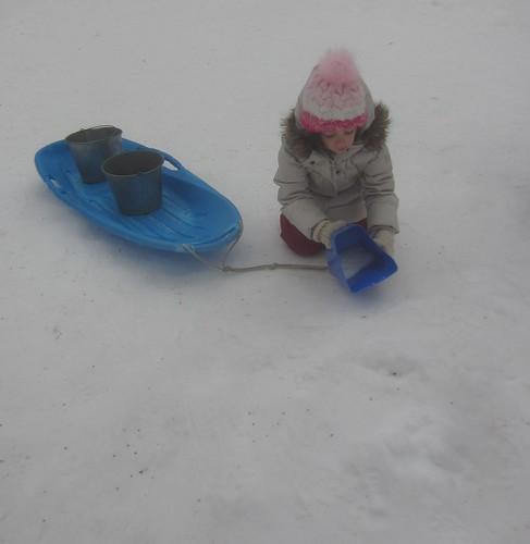 scooping snow