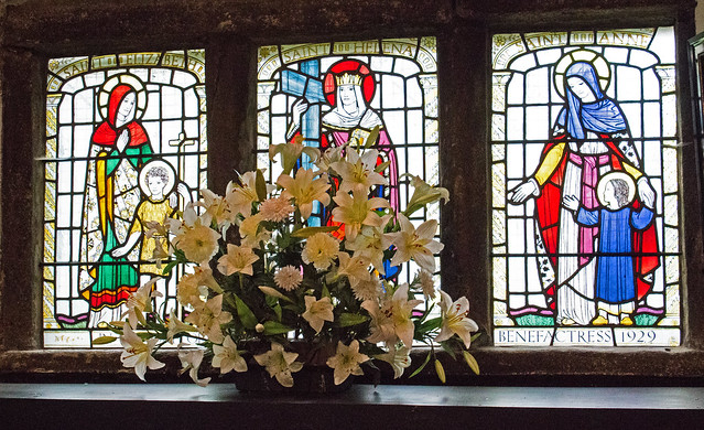 Flowers on the stained glass window sill