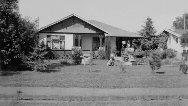 1946 Rolly & Ryllis D'Anvers' house at Hastings. Ryllis & son, John on the front lawn.