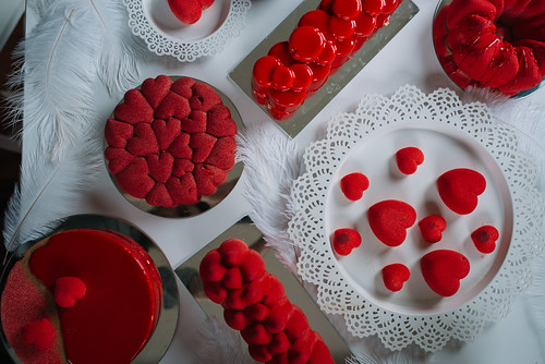 Valentine cake and cookies decoration in red colors. Top view | by shixart1985