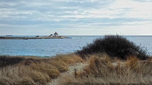 watchhilllight watchhill lighthouse westerly rhodeisland ocean dune sand clouds sky dunes