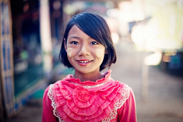 A young girl in pink top