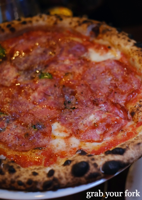 Woodfired sourdough pizza with sopressa, honey and mozzarella at Dimitri's Pizzeria on Oxford Street in Darlinghurst Sydney
