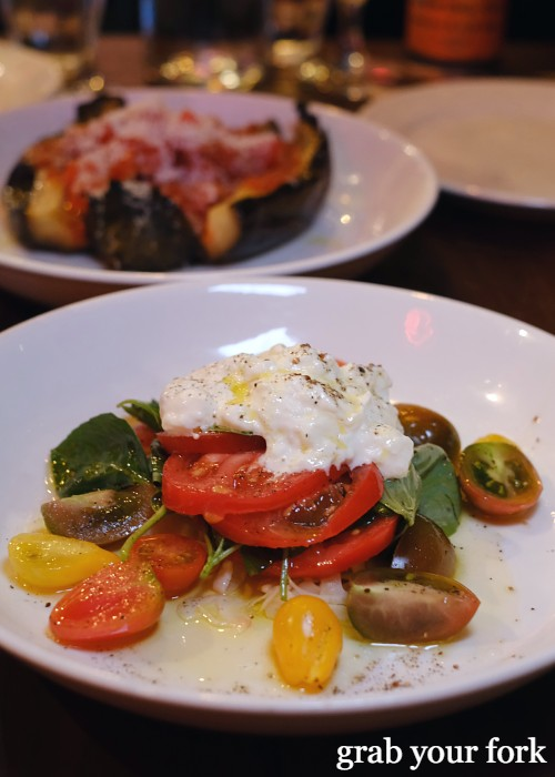 Heirloom tomatoes and housemade stracciatella from Dimitri's Pizzeria on Oxford Street in Darlinghurst Sydney