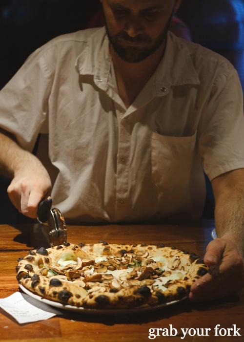 Mushroom and mozzarella woodfired sourdough pizza at Dimitri's Pizzeria on Oxford Street in Darlinghurst Sydney