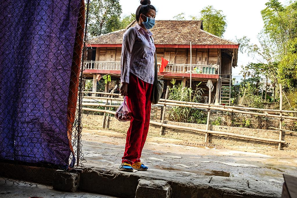 Tai woman just outside tiny shop--Ban Banh