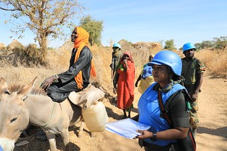 UNAMID peacekeepers provide protection to local women in Aurokuom village farming area south Zalingei, Central Darfur. | by UNAMID Photo