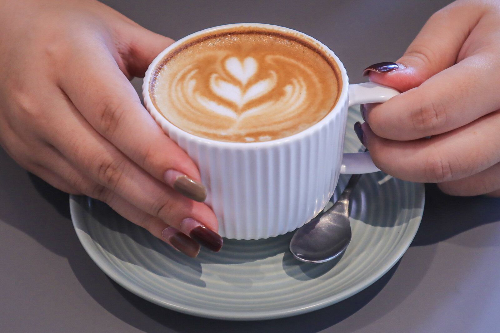 gather hands holding cup 2