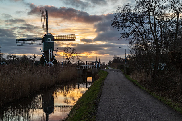 Sunset behind the polder mill