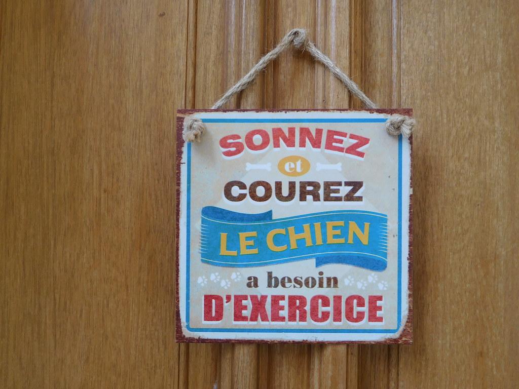 Humorous warning plaque on a door - People too!