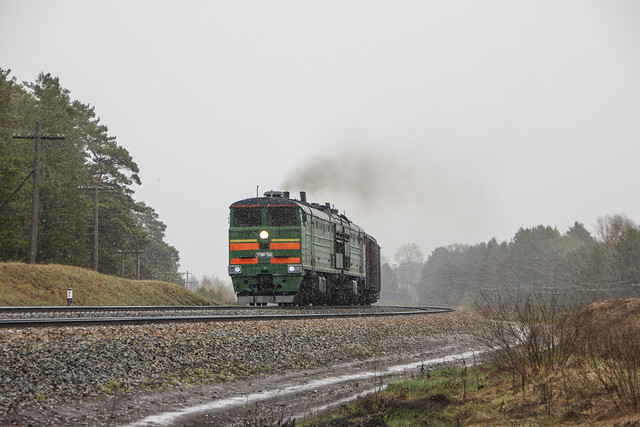 2TE10M-3562 diesel locomotive with freight train
