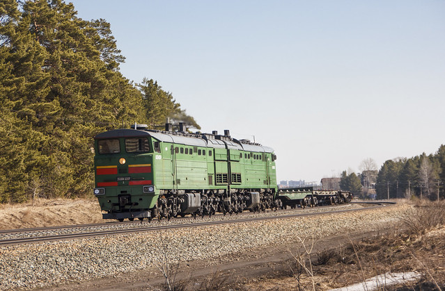 2TE10M-3203 diesel locomotive with freight train