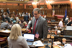 Rep. John Fusco talks with a colleague during the opening day of the 2020 legislative session.