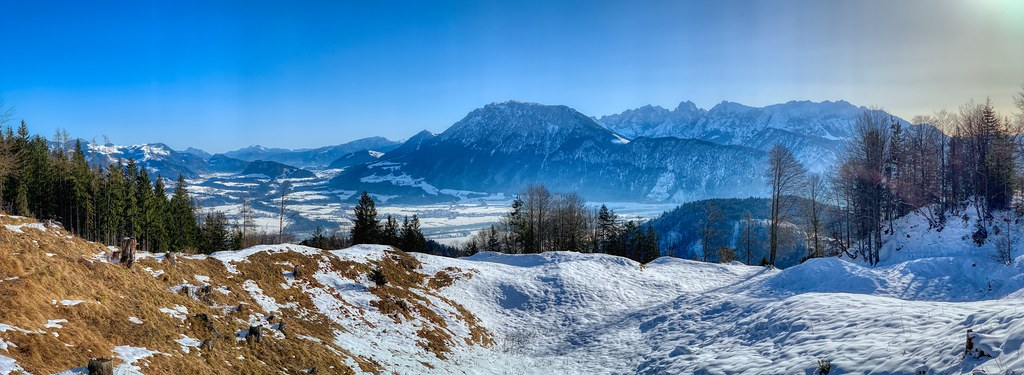 Winter panorama of river Inn valley and Kaiser mountains seen from Schwarzenberg mountain near Oberaudorf, Bavaria, Germany