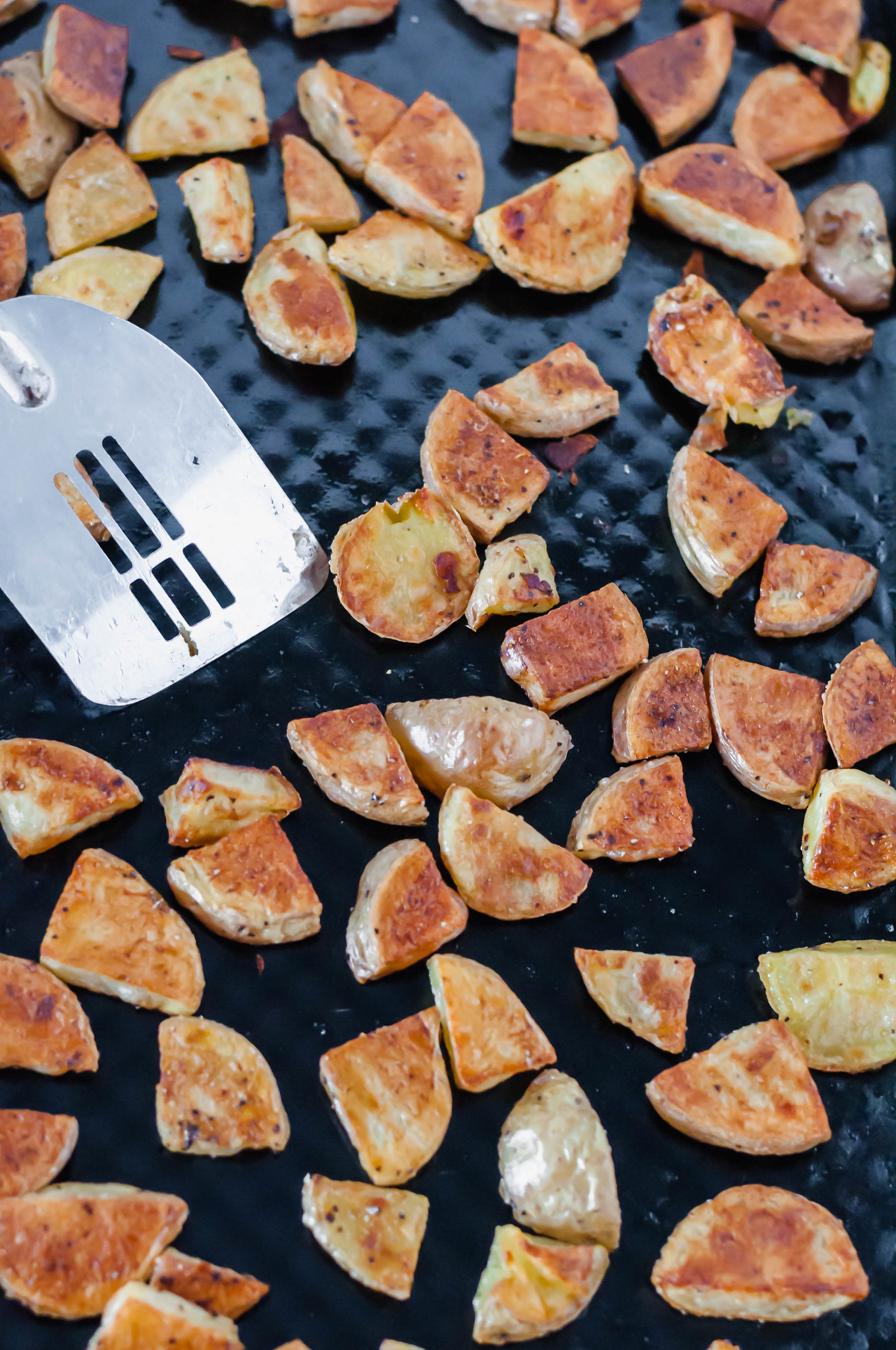 Learn how to make the crispiest potatoes around. These Crispy Roasted Potatoes are simple to make. The crispy exterior and tender, fluffy interior will blow your mind. Read the post for all the tips on making crispy roasted potatoes.
